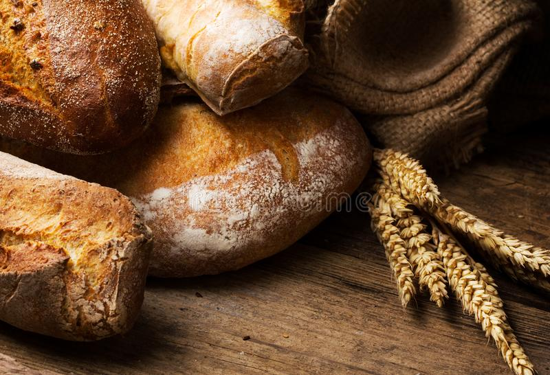 Fresh backed bread on wooden background royalty free stock images