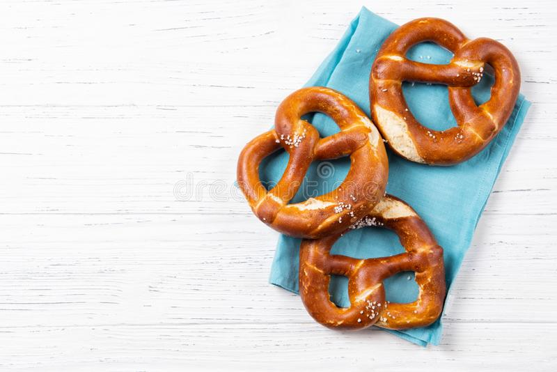 Fresh backed pretzels on a blue towel, beer snack, top view with copy space stock photography