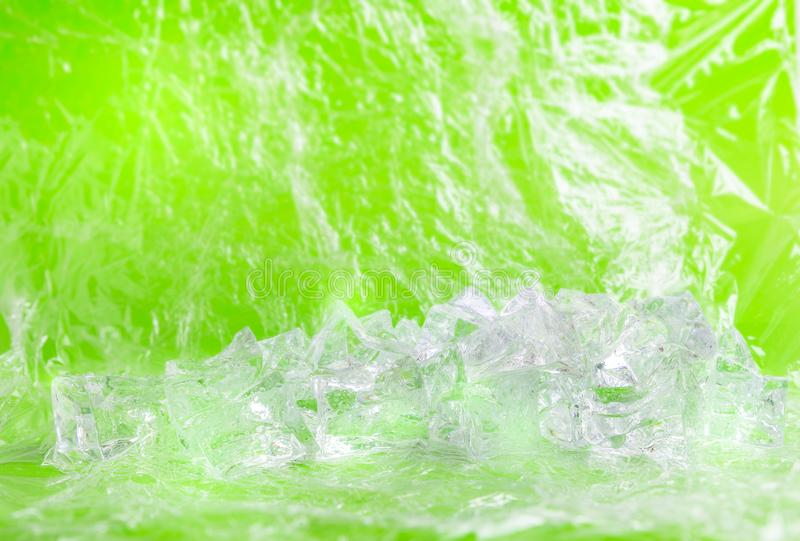 Fresh background with group of ice cube. For product presentation in freshness or summer concept. Green background royalty free stock images