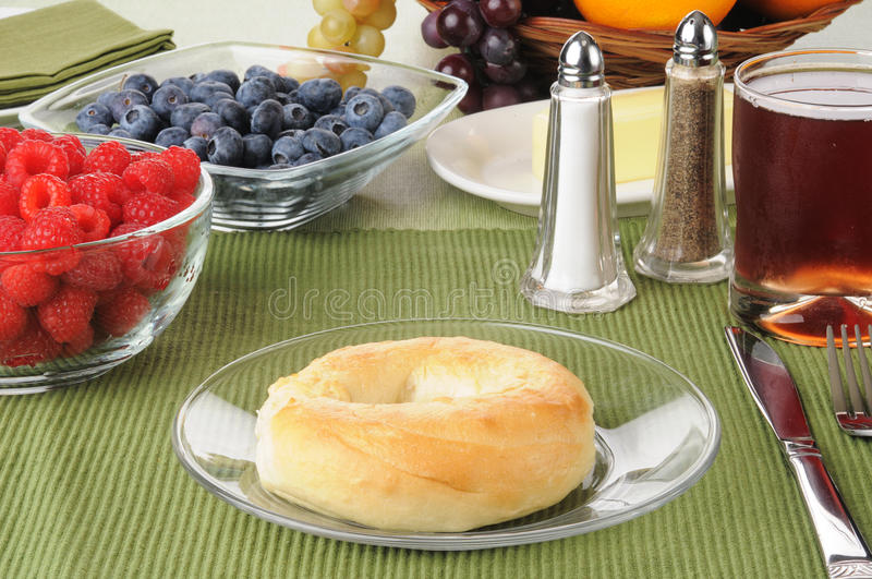 Fresh bagel with berries stock photography