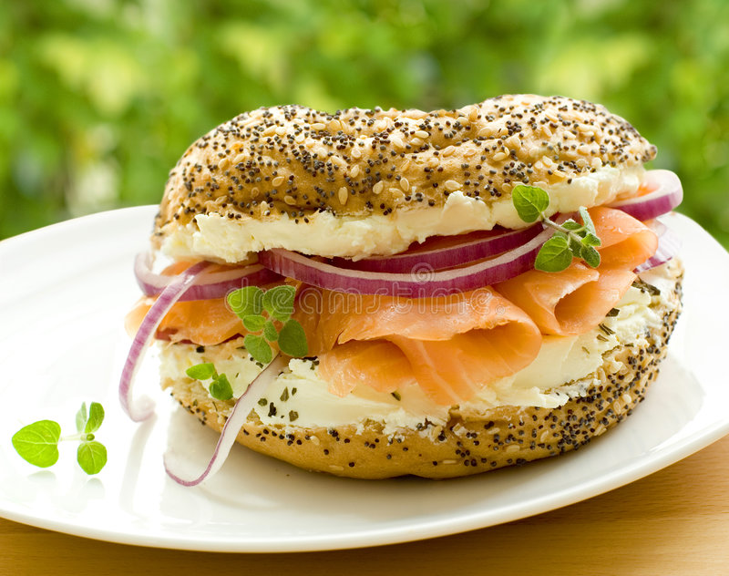 Fresh bagel with salmon royalty free stock photos