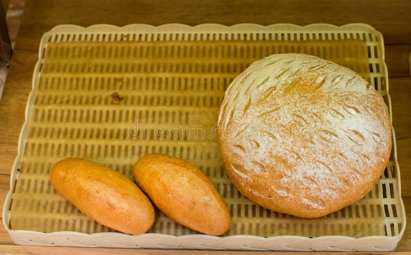 Fresh baguette. Basket of `French bread`, traditional Brazilian bread, present at tables and meals throughout the country. Fresh baked bread on table of royalty free stock image