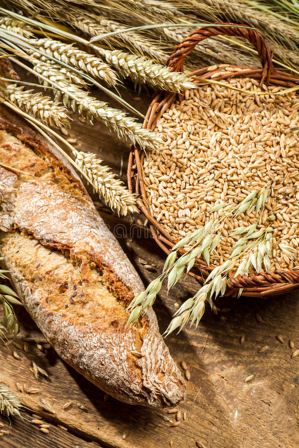 Fresh baguette with cereal grains in a basket stock images