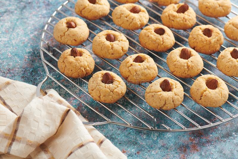 Fresh baked almond cookies on stainless steel grille stock photo