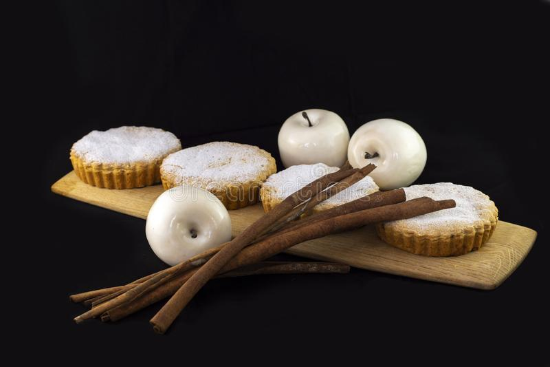 Fresh baked Apple pie decorated with cinnamon sticks. On wood royalty free stock photography