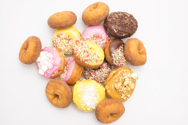 Fresh baked assorted donuts. Assorted donuts on a white background stock image