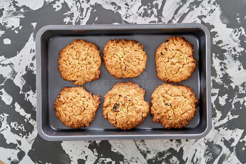 Fresh baked biscuits on a cookie sheet, top view, close-up, selective focus, shallow depth of field. Fresh baked tasty biscuits on a cookie sheetover abstract royalty free stock image