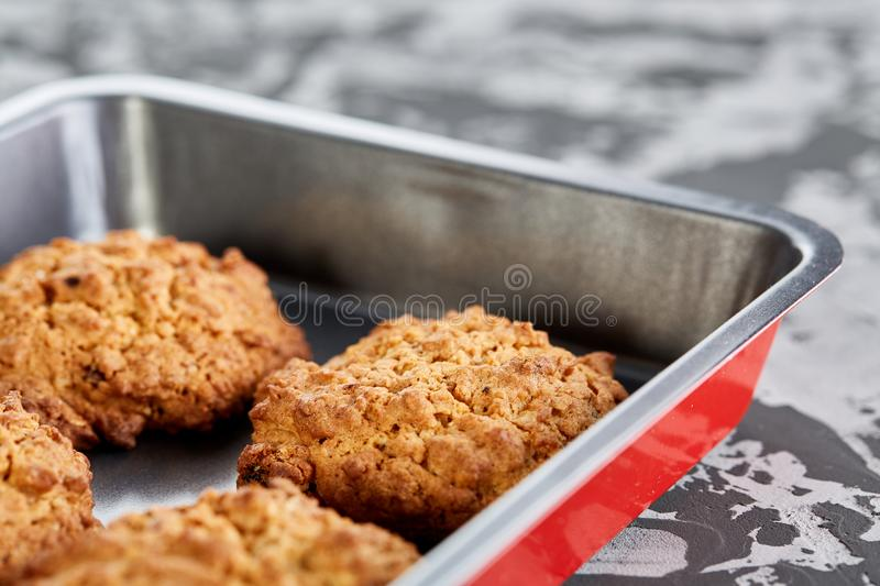 Fresh baked biscuits on a cookie sheet, top view, close-up, selective focus, shallow depth of field. Fresh baked tasty biscuits on a cookie sheetover abstract stock photography