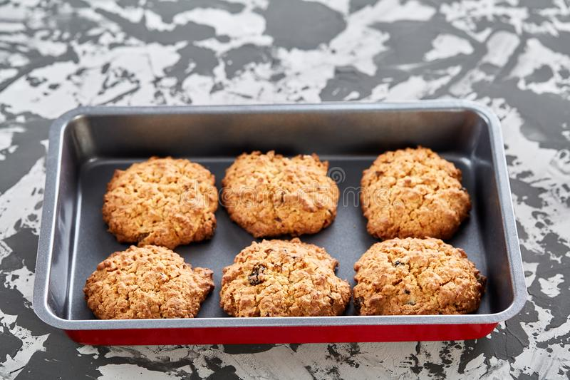 Fresh baked biscuits on a cookie sheet, top view, close-up, selective focus, shallow depth of field. Fresh baked tasty biscuits on a cookie sheetover abstract royalty free stock photo