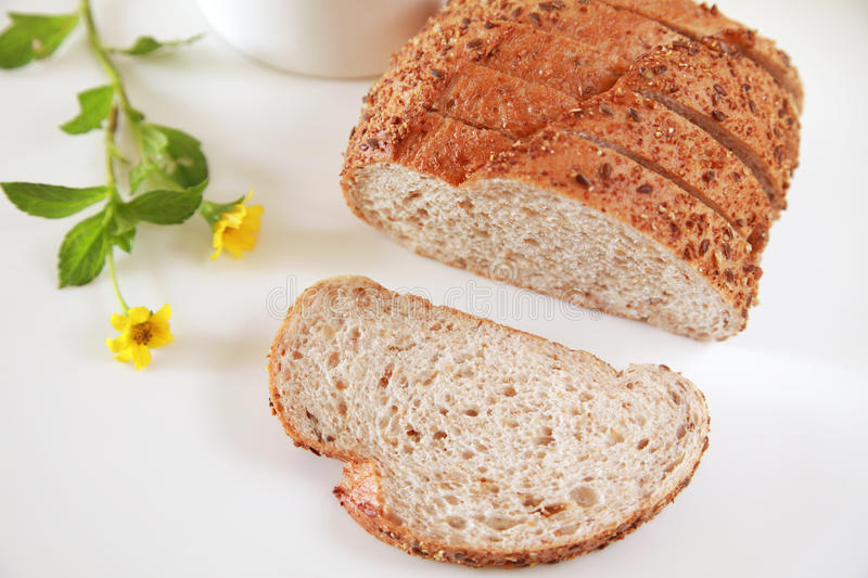 Fresh Baked Bread. On Witer Background, one sliced royalty free stock photos