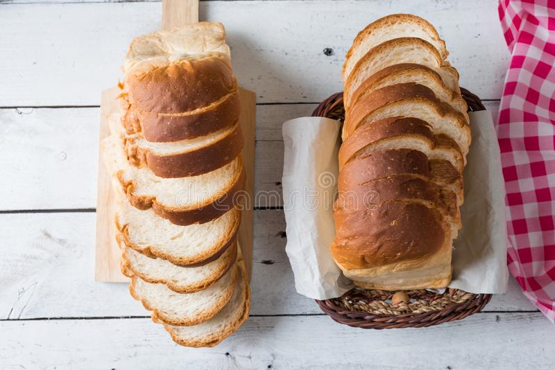 Fresh baked bread and sliced bread on rustic wooden table stock photos
