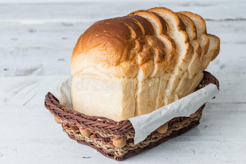 Fresh baked bread and sliced bread on rustic wooden table royalty free stock images