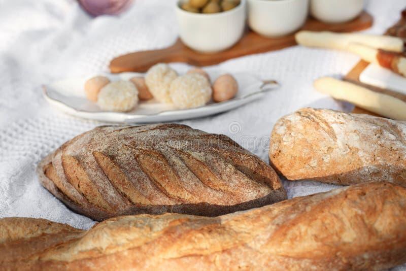 Fresh baked bread on white blanket. bakery concept. Fresh baked bread on white blanket stock photos