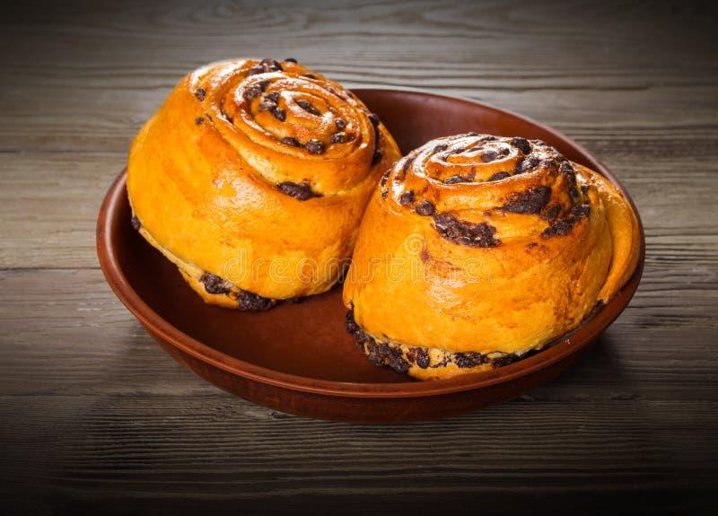 Fresh baked bun with chocolate royalty free stock photos