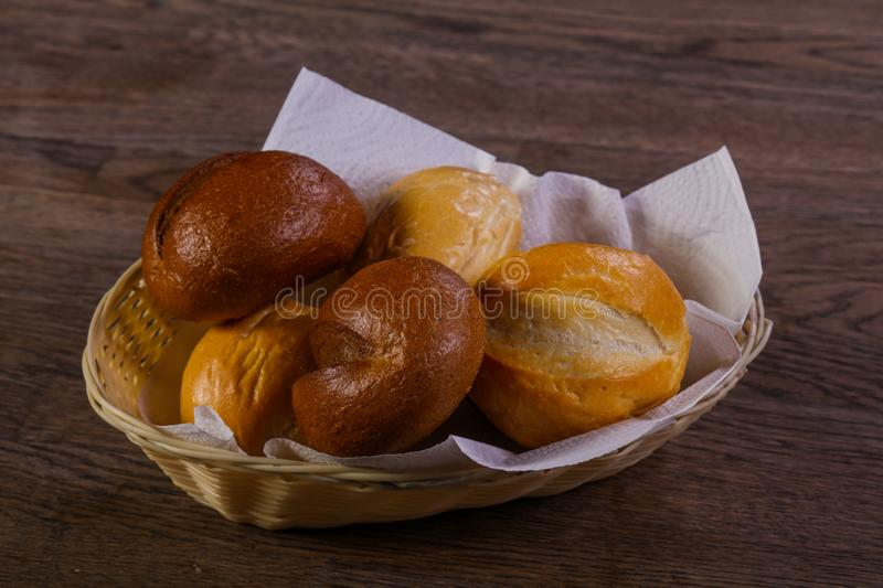 Fresh baked buns. Over the wooden royalty free stock photography