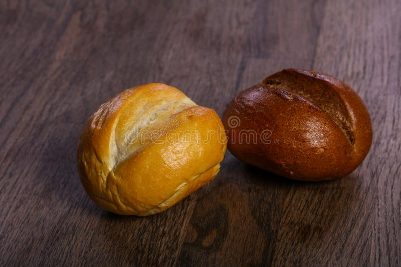 Fresh baked buns. Over the wooden stock photo
