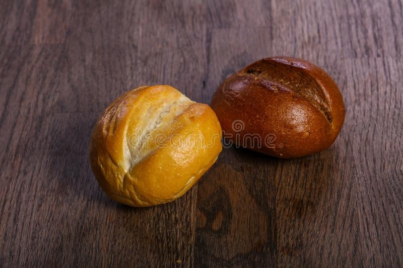 Fresh baked buns. Over the wooden royalty free stock photo