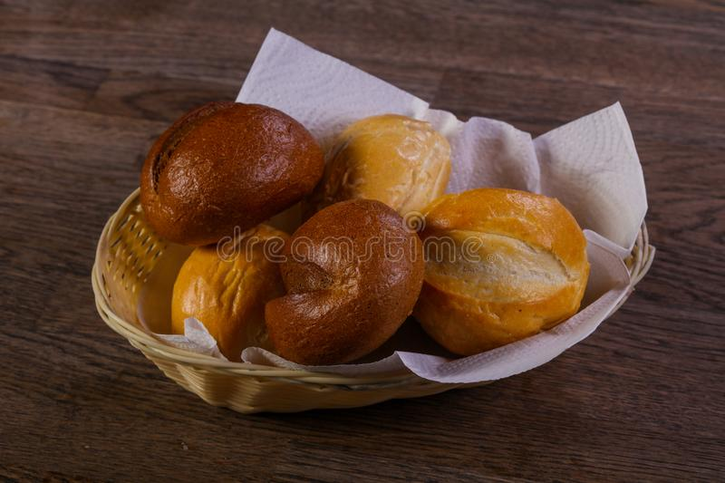 Fresh baked buns. Over the wooden stock images