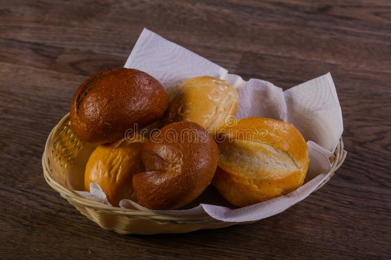 Fresh baked buns. Over the wooden royalty free stock image