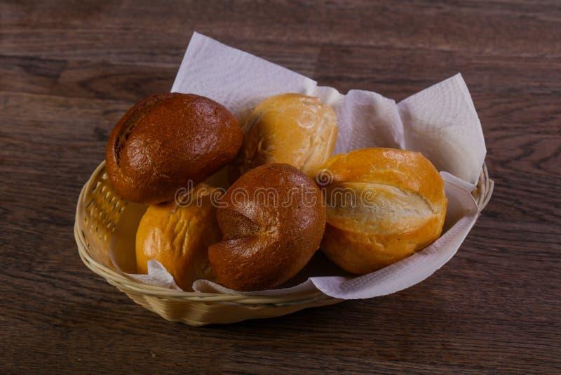 Fresh baked buns. Over the wooden stock photos