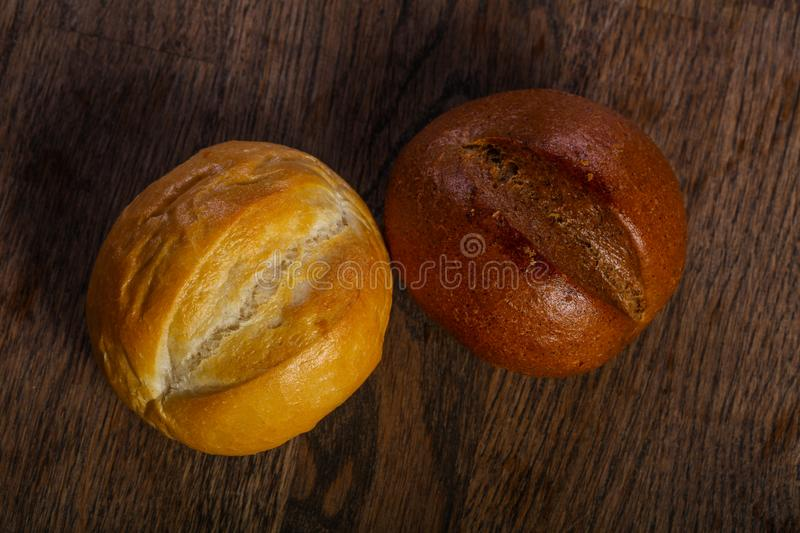 Fresh baked buns. Over the wooden stock photography