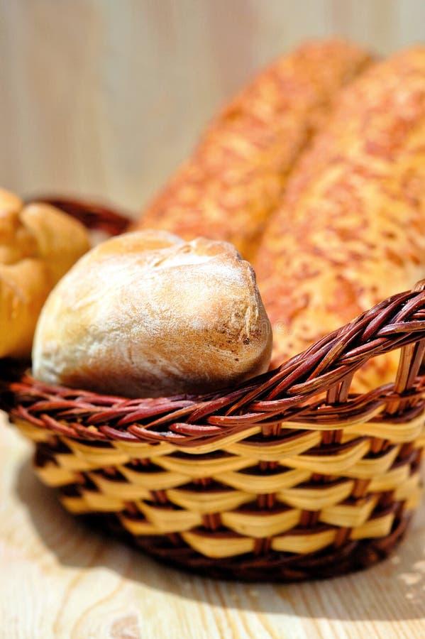 Fresh baked buns in a wicker basket stock photos