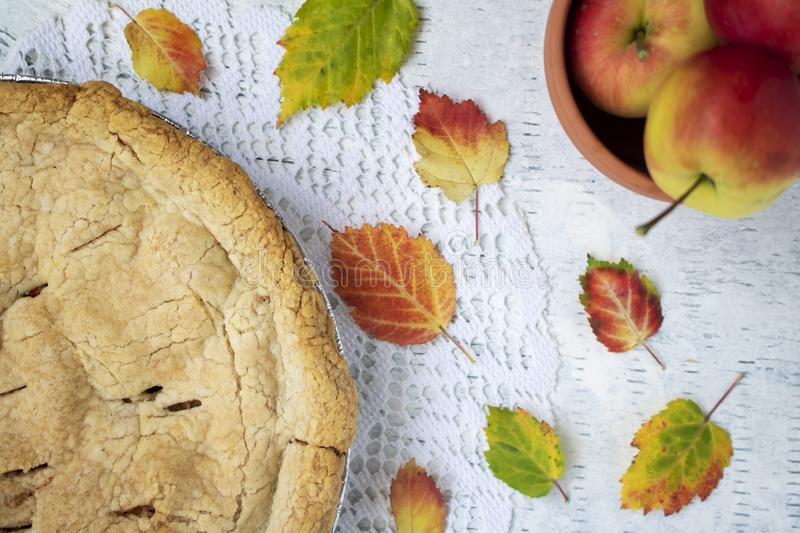 Fresh baked crabapple pie displayed with apples and autumn leaves. Fresh baked crab apple pie displayed with colorful autumn leaves stock photos