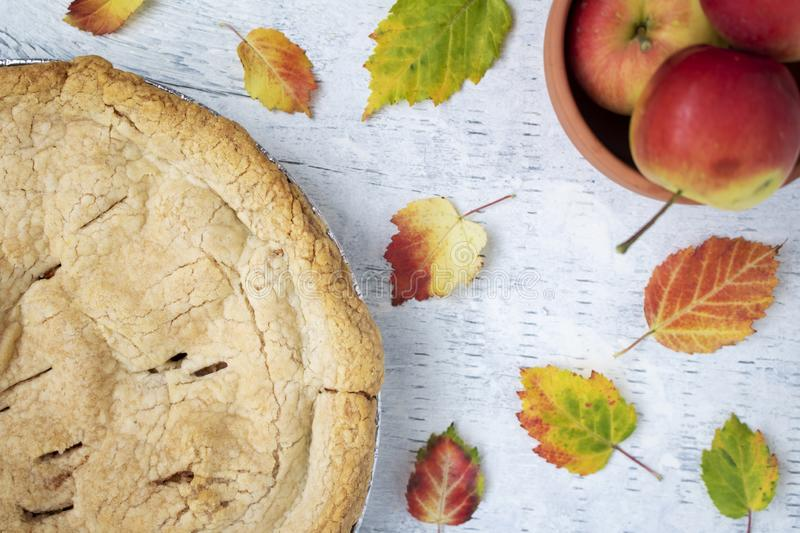 Fresh baked crabapple pie displayed with apples and autumn leaves. Fresh baked crab apple pie displayed with colorful autumn leaves stock photo