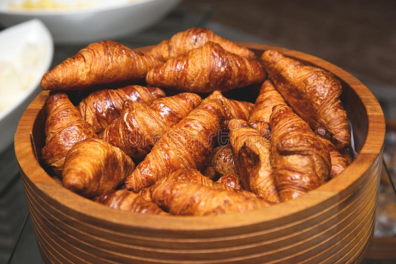 Fresh baked goods in a box. Fresh delicious croissants royalty free stock images