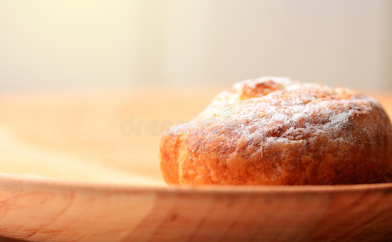 Fresh baked goods. On wooden plate royalty free stock image