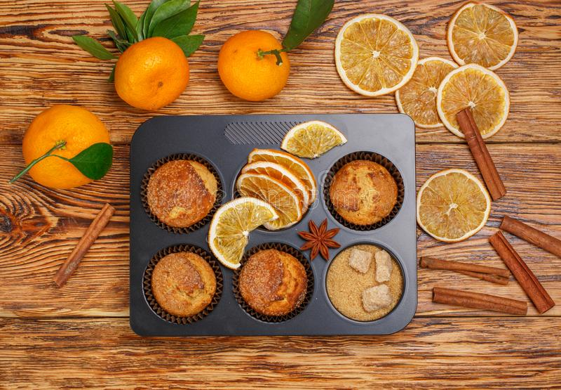 Fresh baked homemade citrus orange, Mandarin cakes muffins royalty free stock photos