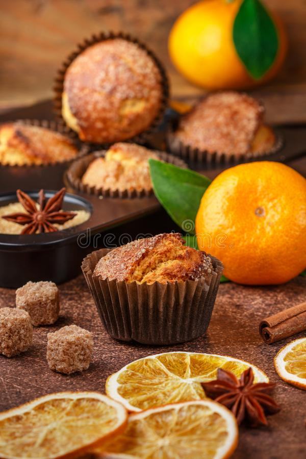 Fresh baked homemade citrus orange, Mandarin cakes muffins with brown sugar, cinnamon and star anise royalty free stock photos