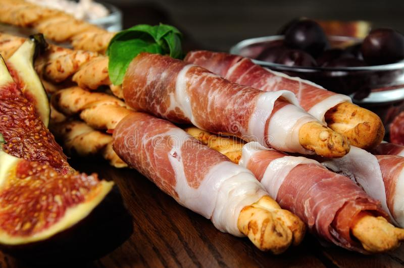 Grissini with prosciutto royalty free stock photo