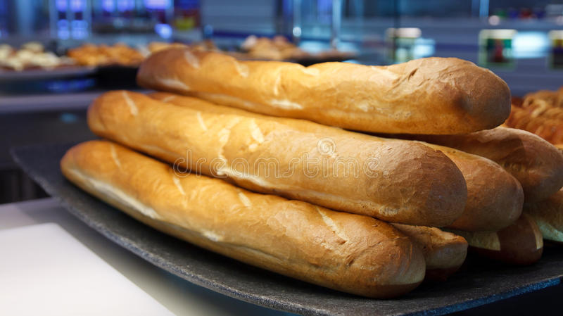 Fresh Baked Loaves of French Bread. Long loaves of fresh baked french bread at a bakery stock photos
