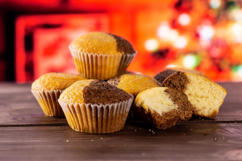 Fresh baked marble muffin with christmas tree behind. Group of four whole two halves of fresh baked marble muffin with christmas tree in red background stock images