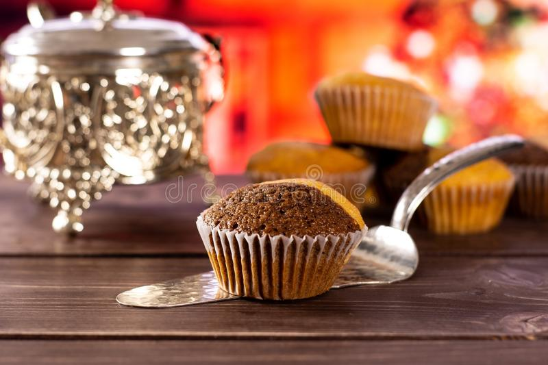 Fresh baked marble muffin with christmas tree behind royalty free stock photos