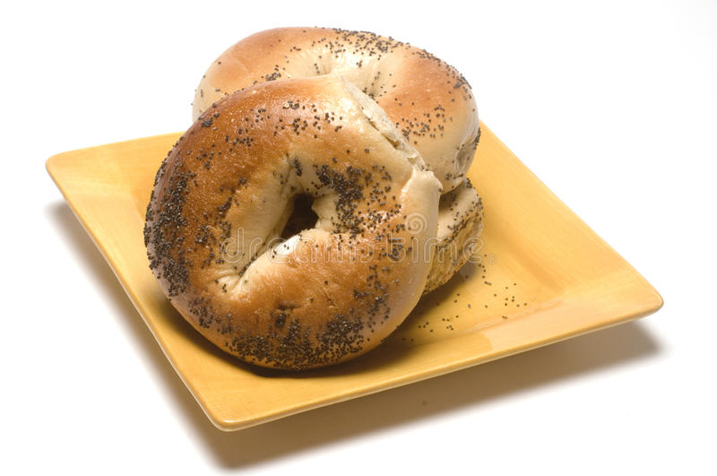 Fresh Baked Poppy Seed Bagels On Plate Stock Image