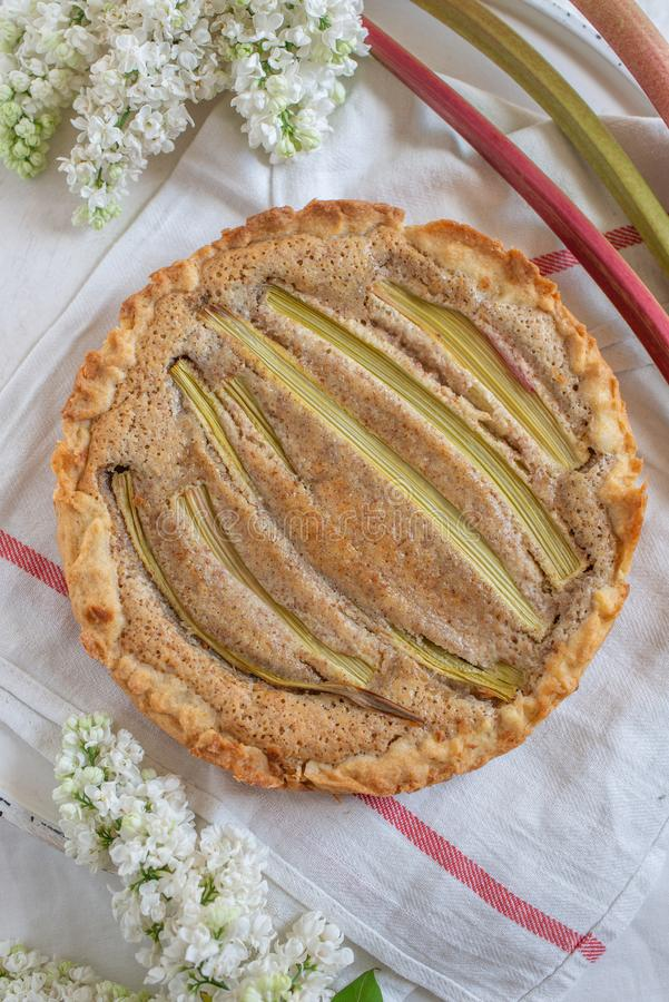 Fresh baked rhubarb tart on a table royalty free stock photography