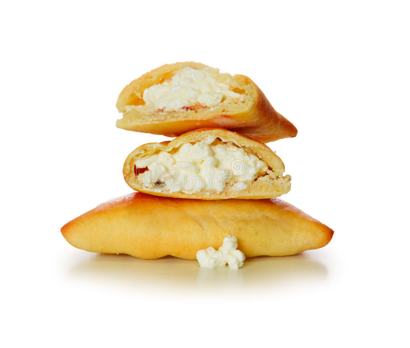 Fresh baked russian pastry pirozhki with cottage cheese royalty free stock photo