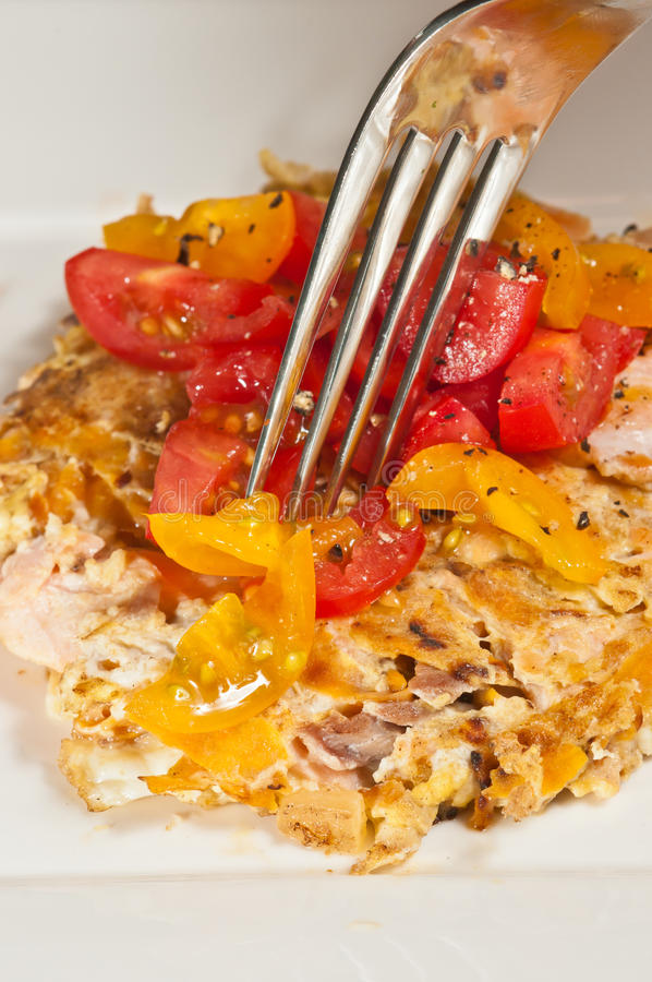 Fresh, baked salmon, egg and heirloom tomatoes, paleo diet royalty free stock image