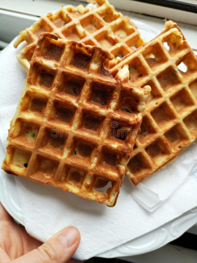 Fresh baked waffles on a plate stock photos