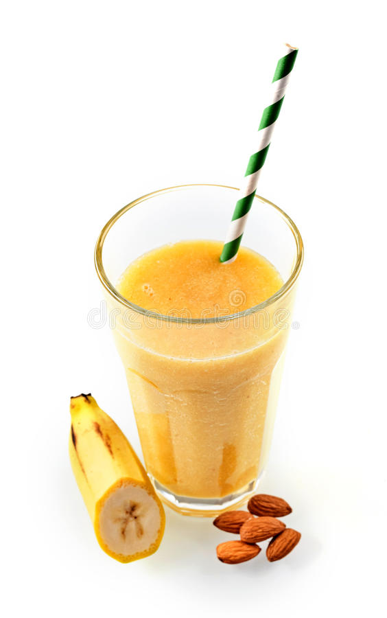 Fresh banana and almond drink in tall glass royalty free stock photo