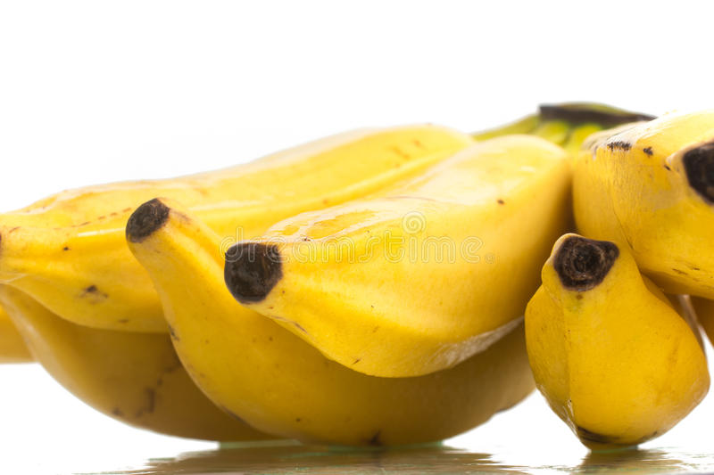 Fresh Banana Fruit. Over a wet white background stock images