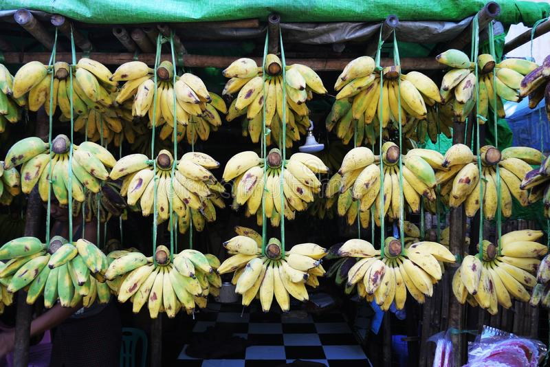 Fresh banana street stall vendor at traditional agriculture market. Grocery stock photos