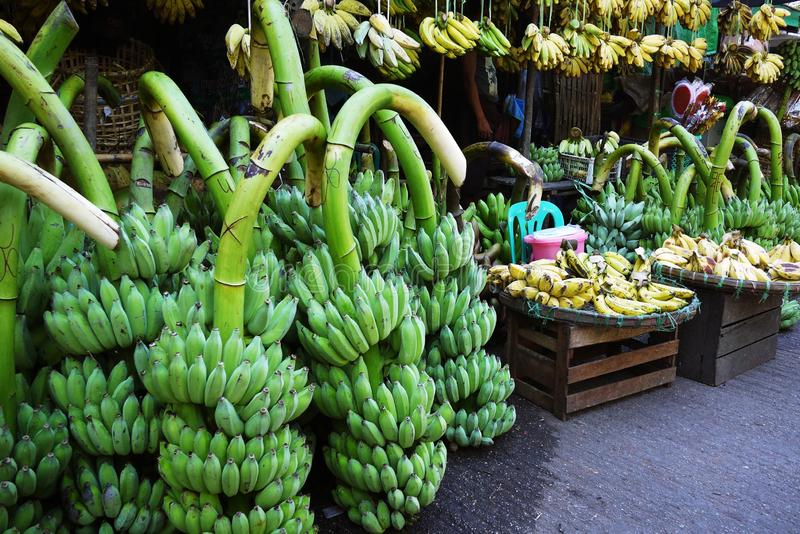 Fresh banana street stall vendor at traditional agriculture market. Grocery royalty free stock image