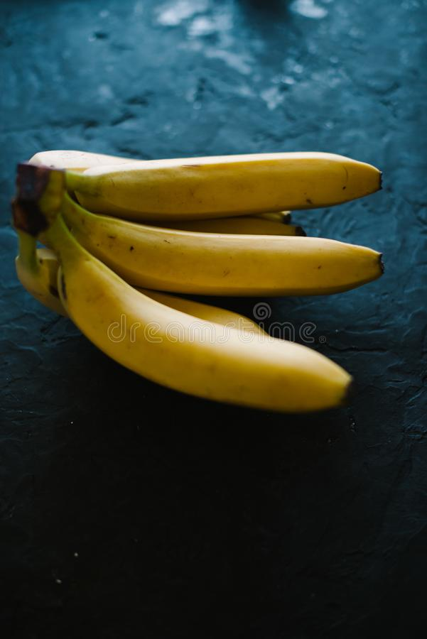 Fresh bananas on a black matte background stock photos