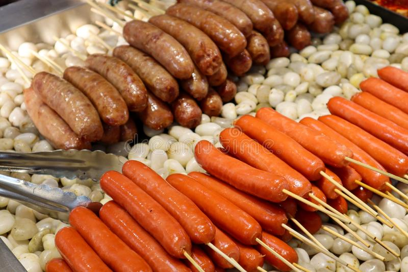 Fresh bbq sausages as traditional chinese street food royalty free stock images