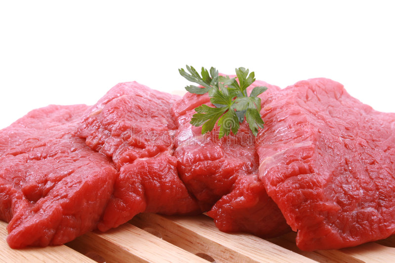Fresh beef. On board ready to cook isolated on white royalty free stock photography