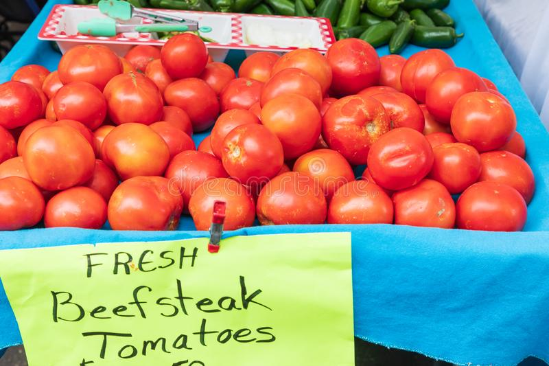 Fresh beefsteak tomatoes for sale at a farmers market royalty free stock photography