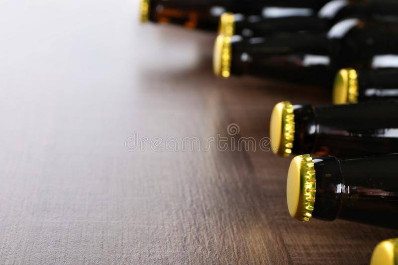 Fresh beer in glass bottles on wooden background,. Closeup stock photos
